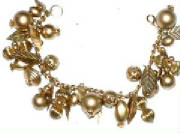 Goldtone multi charm bracelet